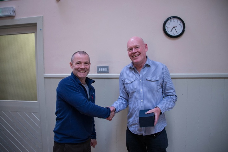 Winner Graeme Youngson being presented with the trophy for Photo of the Year by club chairman Icarus Owen